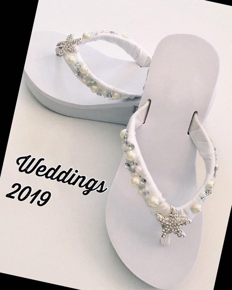 bec563f9c626 White Wedding Flip Flops. White Flip Flops Beach Wedding