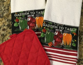 Two Kitchen Dish Towels with fabric  trim added with one pot holder