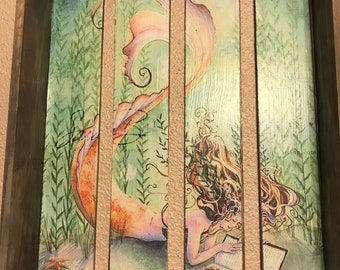 Wooden shadow bozx with mermaid image reading a book