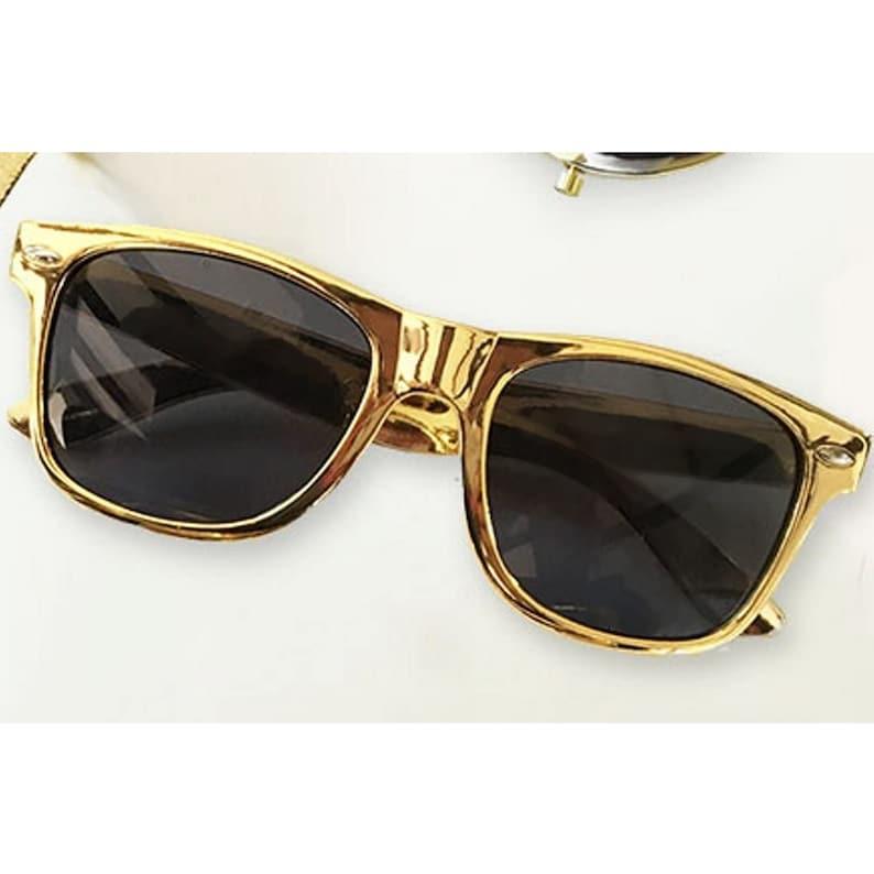 5.25 long x 1.75 wide Gold Sunglasses