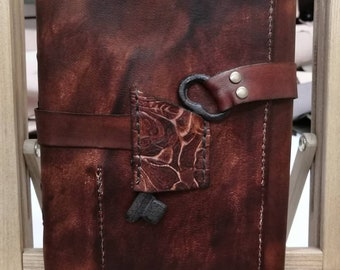 Genuine leather journal or sketchbook tri-fold with old iron skeleton key