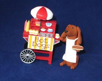 Dachshund hot dog vendor figurine