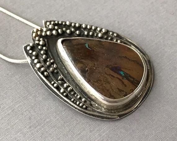 Boulder opal pendant with granulation