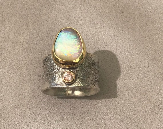 Crystal opal and sapphire in 18k gold ring