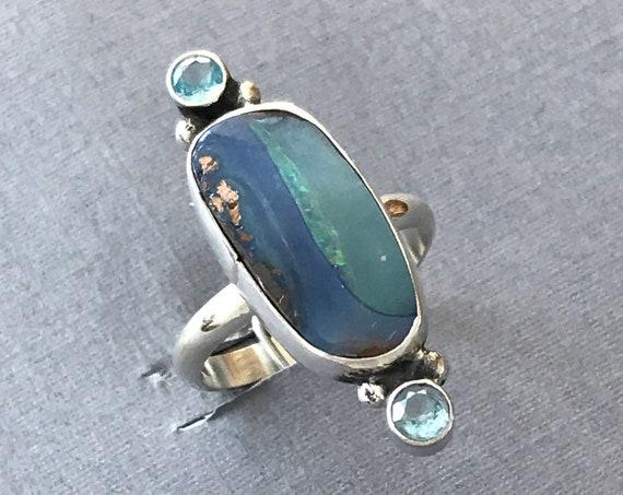 Australian boulder opal and topaz ring