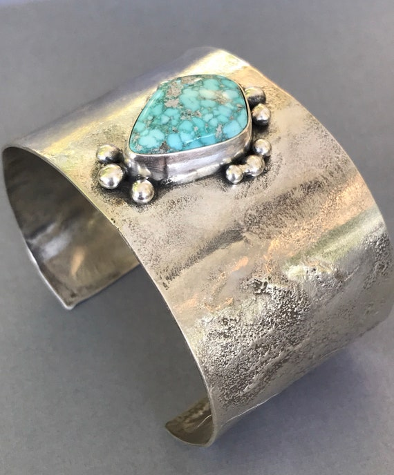 White water turquoise on a reticulated silver cuff with granulation details