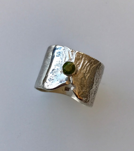 Olive green sapphire ring on reticulated silver