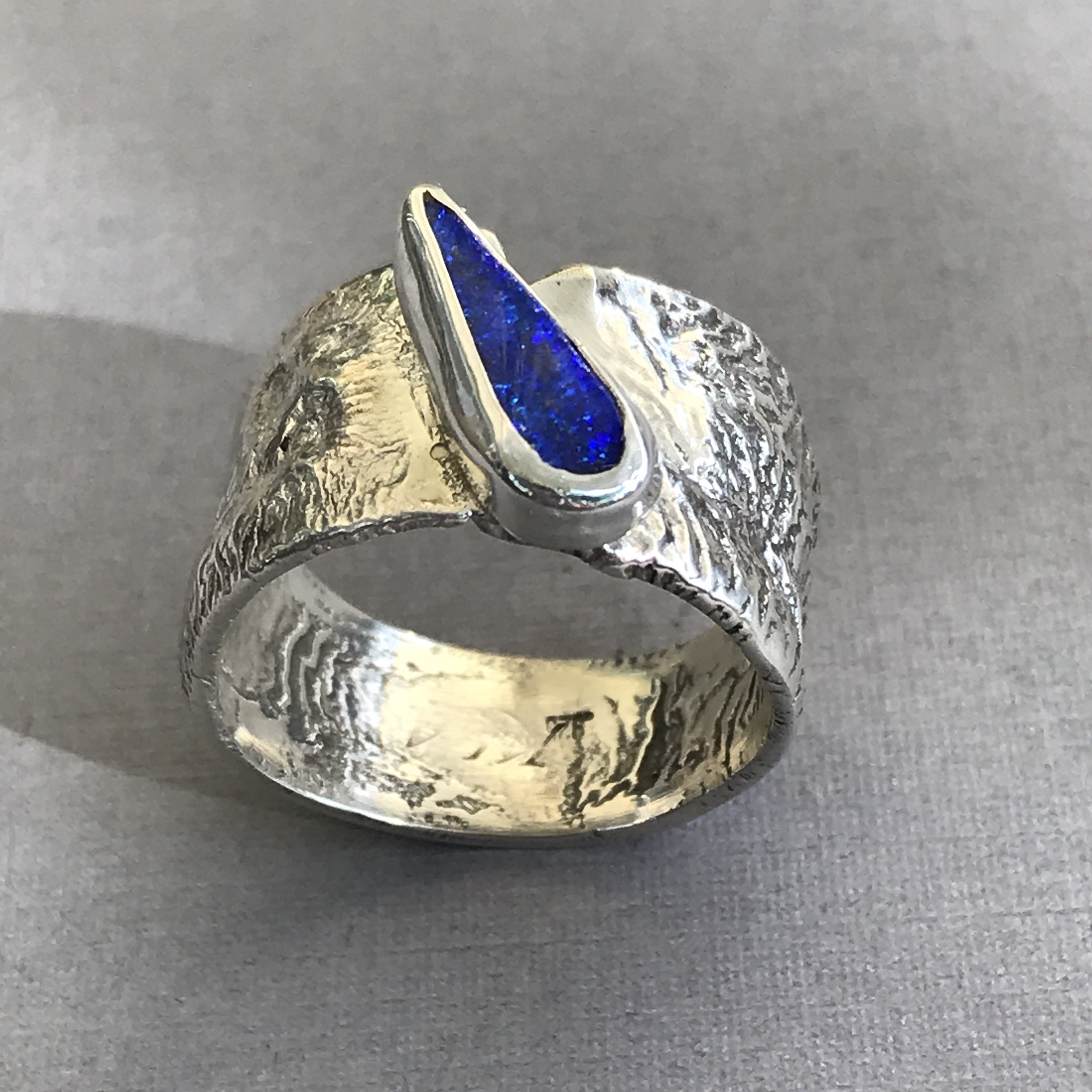 Wide band Australian Boulder Opal ring in reticulated silver