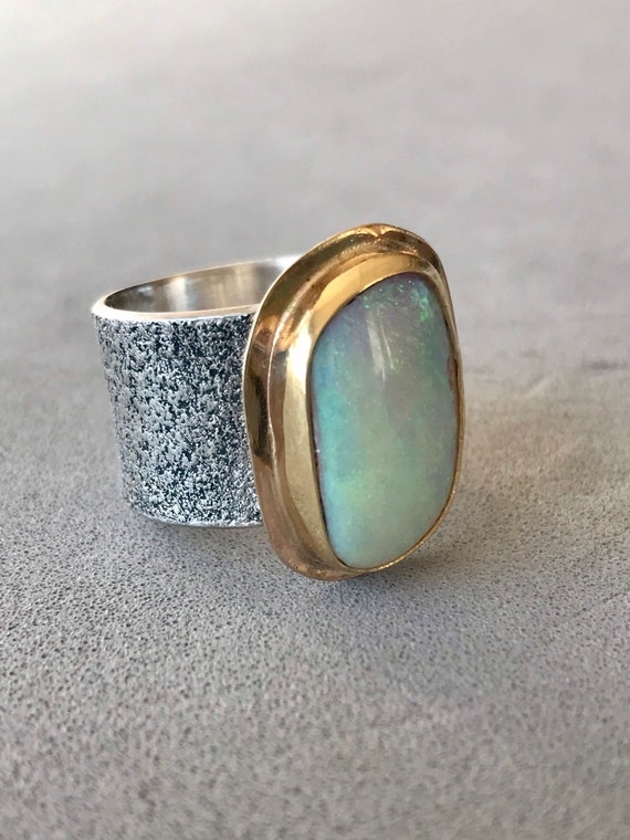 Large crystal opal ring framed with yellow gold