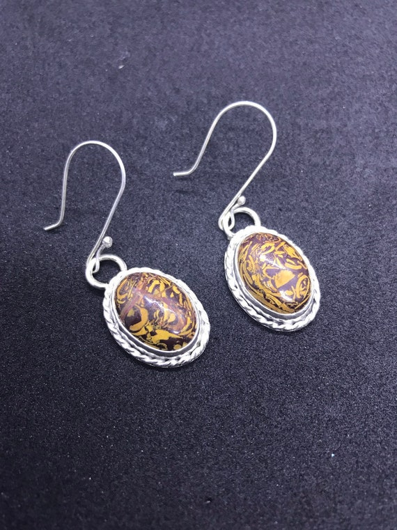 Golden silk jade earrings