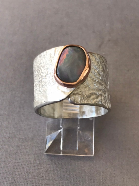 Lightning ridge opal in rose gold on a wide band adjustable ring