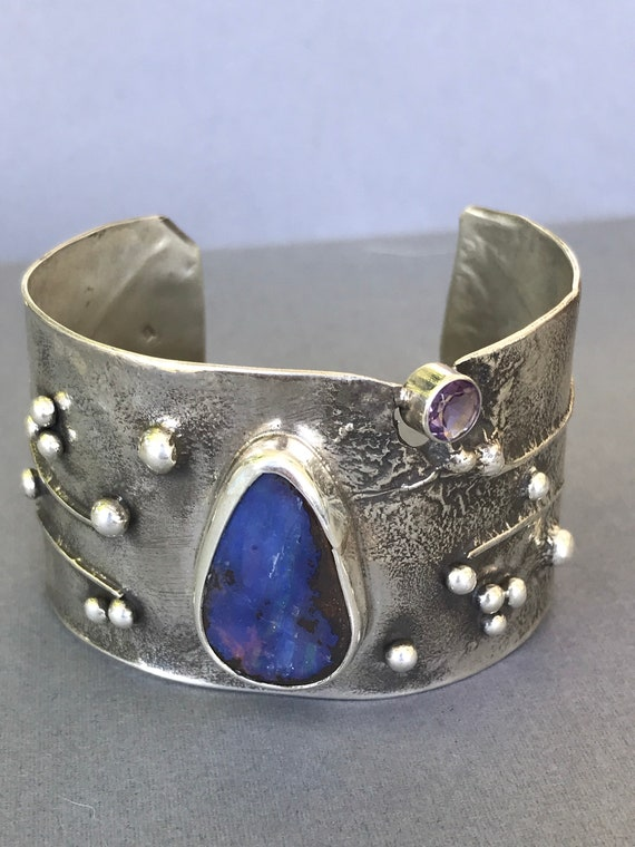 Australian Boulder Opal and amethyst on reticulated silver cuff