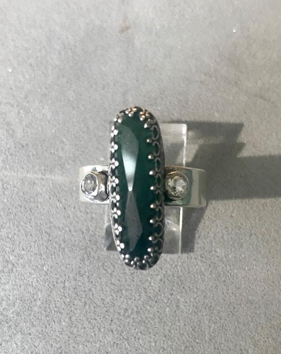 Green tourmaline and white topaz ring