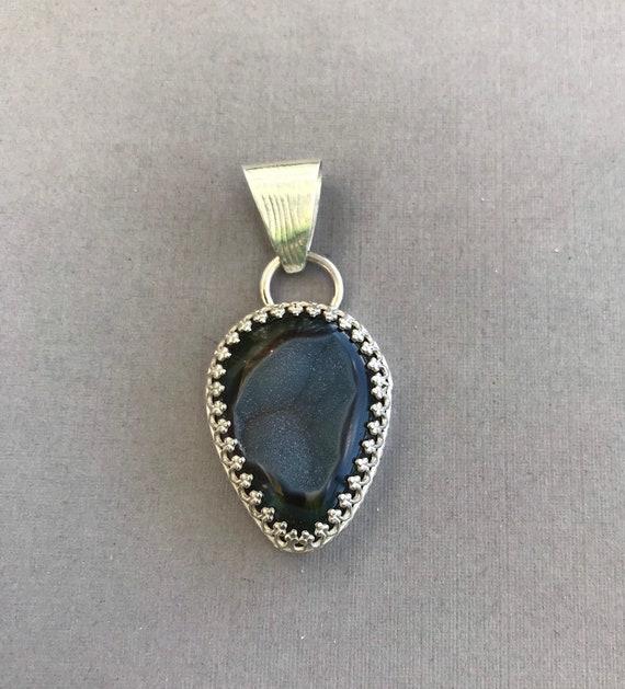 Banded black onyx druzy pendant