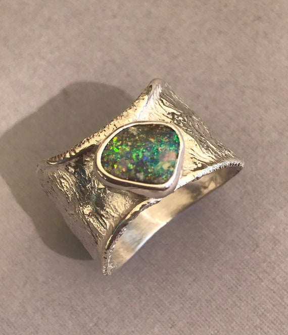 Australian Boulder Opal set in reticulated silver ring