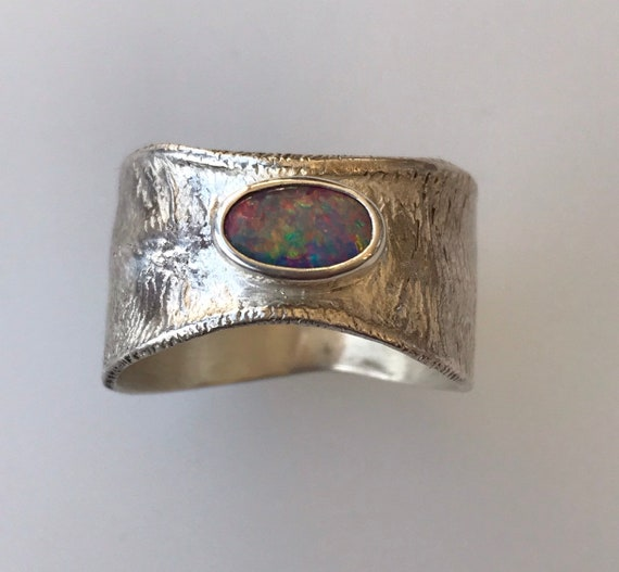 Lightning Ridge opal ring on reticulated silver