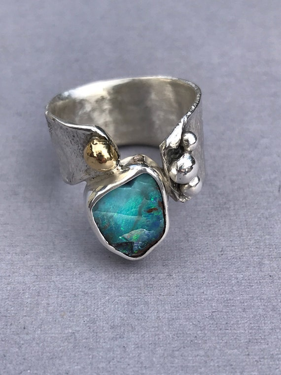 Reticulated sterling silver and Boulder Opal ring with an 18 k gold embellishment