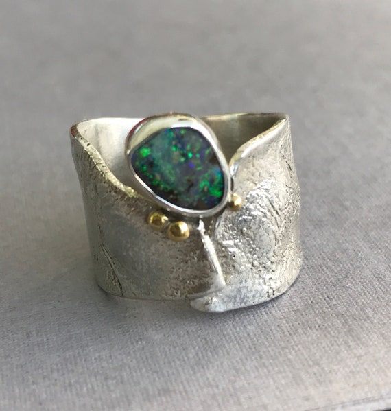 Australian Boulder Opal ring on reticulated silver band with 18k gold granulation