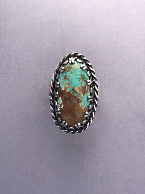 Royston ribbon turquoise set with a gallery bezel  Size 8-1/4