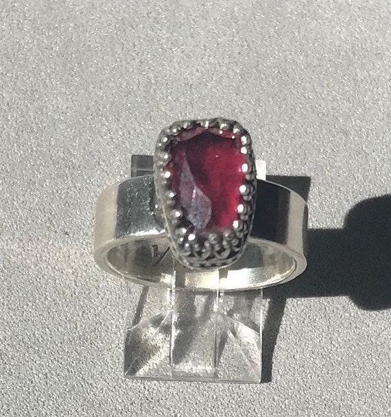 Rose cut garnet in a gallery bezel ring