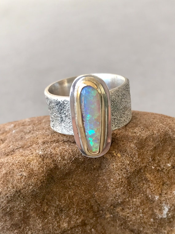 Crystal pipe opal in gold and silver ring