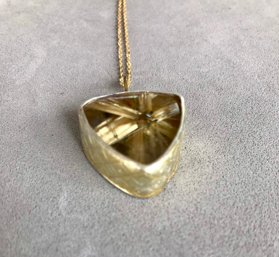Rutilated Quartz with a textured bezel and 22k gold overlay pendant