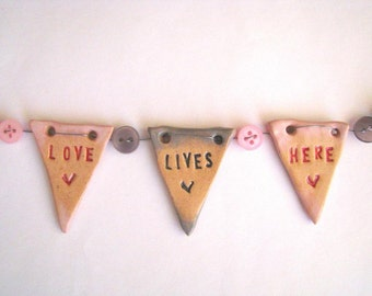 Love Lives Here - mini ceramic bunting