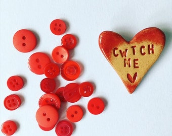 Cwtch Me - Hug me - in Welsh - heart brooch / pin / button / badge. Ceramic. Made in Wales, UK. Free UK P&P