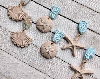 Sea and Sand polymer clay earrings dangle pierced sand stamped beach boho starfish sand dollar fan shell