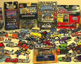 OVER 60 Piece Lot of Diecast in New or Like New condition! Dub City, Hotwheels; Matchbox racing Champions and more!  Cars & Trucks LOT-4