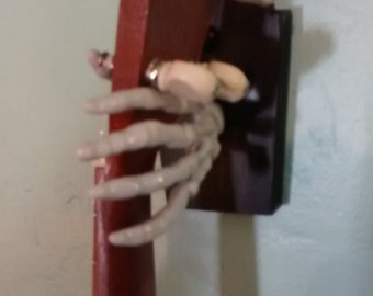 spooky skeleton hand Ukulele wall hanger, left facing.