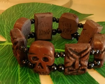 "Original Neat ""Skulls and Tiki's"" bracelet from Tiki King, in ""wood brown"""
