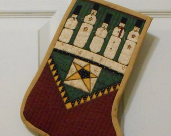 CHRISTMAS STOCKING - QUILTED in antique Red GreenBlack Gold and White approx 13 x 9 in with Snowman.  Handmade by me!