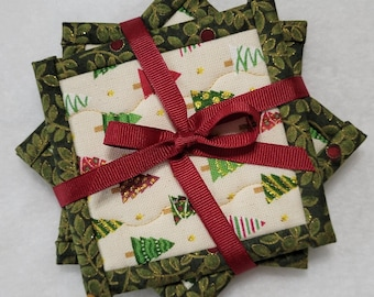 CHRISTMAS TREE COASTERS Set of 4. Approx 4 1/2 inches square in red white and green with gold highlights. Perfect stocking stuffers!