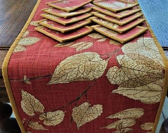 AUTUMN Fall TABLERUNNER with 10 Coasters. Runner  53in x 13.5 in. Coasters  4.5 in square Cotton fabric with course weave. Soft Orange Rust.