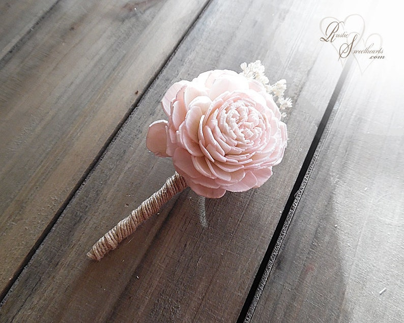 Boutonniere with jute wrapped stem. image 0