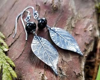 Atropa belladonna - Belladonna (Deadly Nightshade) Leaf Earrings in Pure Silver, Black Onyx  by Quintessential Arts