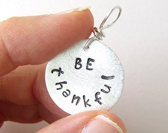 BE THANKFUL.  Christian hand stamped charm in fine silver.  Inspirational jewelry.  Bible quote charm.
