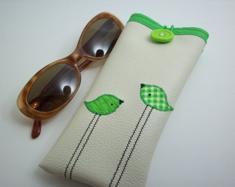 Eyeglass case in cream with green birds