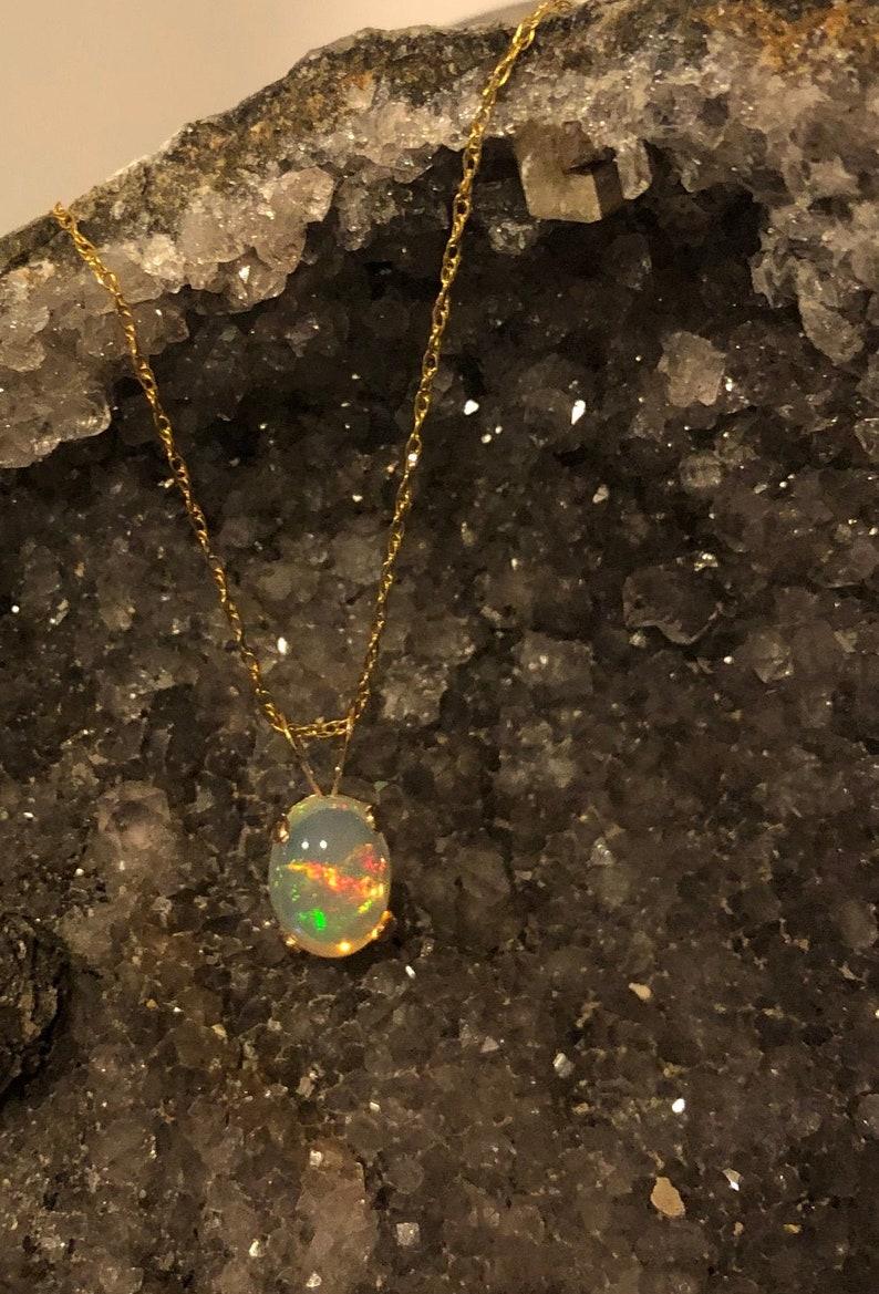 Ethiopian Welo Opal 8x6 14k goldfill or sterling pendant image 0