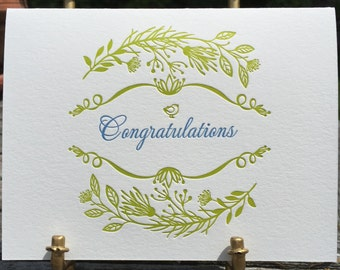 Congratulations in floral frame