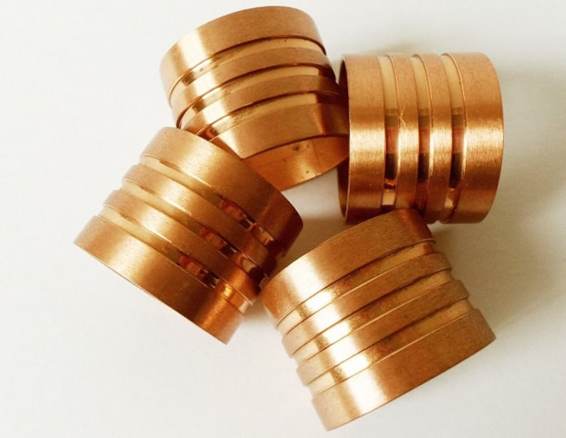 NAPKIN RINGS COPPER METAL HEAVY THICK SET OF 4  COLLECTIBLES