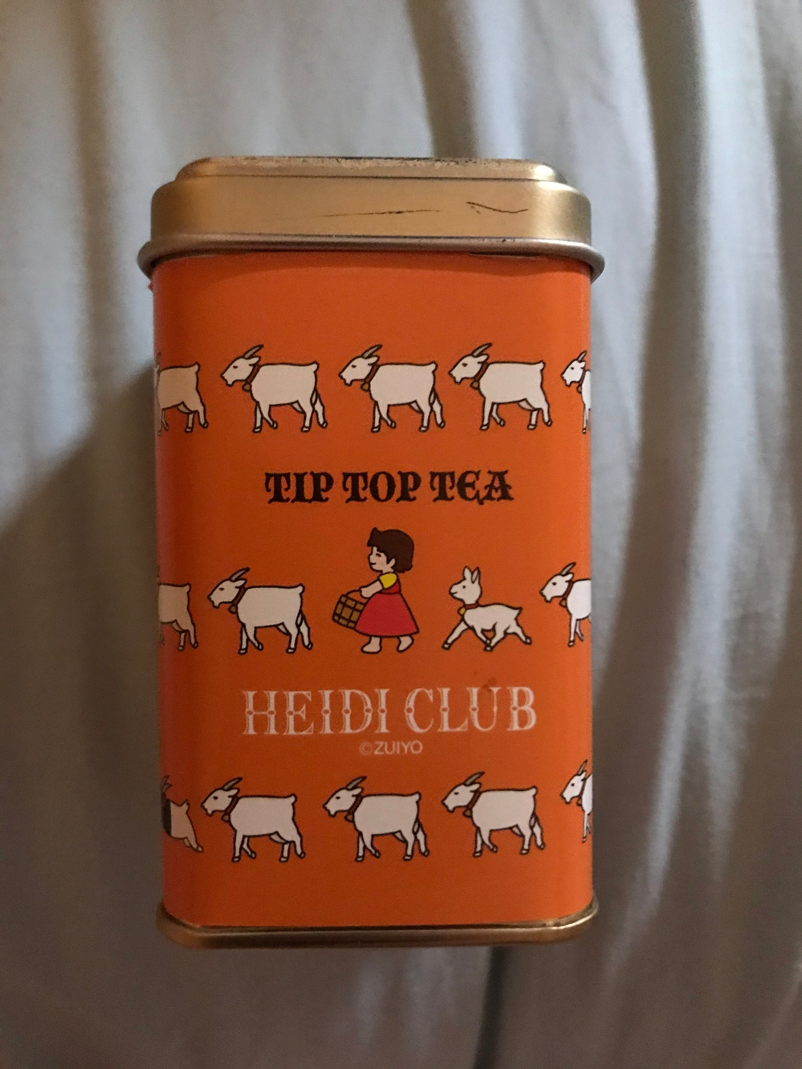 Heidi girl of the alps tip top tea tin container—collectible