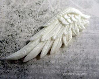 Lifted Carved Bone Wing 60mm Double Sided Undrilled