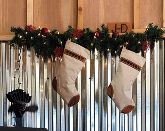 Set of 2 Christmas Stockings with cowboy and cowgirl stamped on the leather