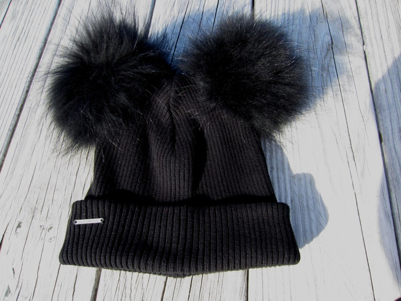 21189bce198 Adult Fur Pom Pom Ear Hat 2 Fur Raccoon Poms Bobble Hat Black