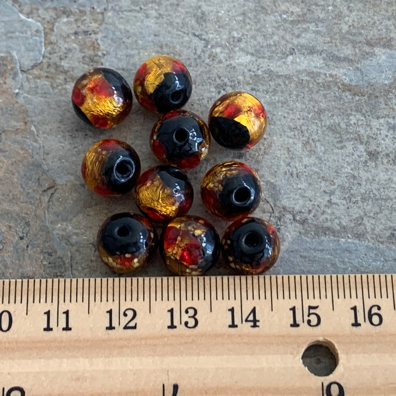 10mm Gold Red and Black Foil Lined Glass Round Beads 10 beads per package