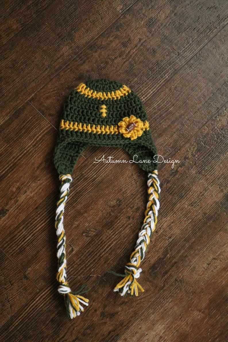 8f1a5d16 Crocheted Football Hat with Earflaps, Braids and Flower Inspired by the  Green Bay Packers- Newborn, 3-6 Mo, 6-12 Mo, Toddler, Child or Adult