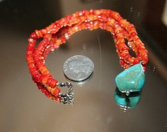 Rich natural red coral and a large blue green turquoise nugget necklace