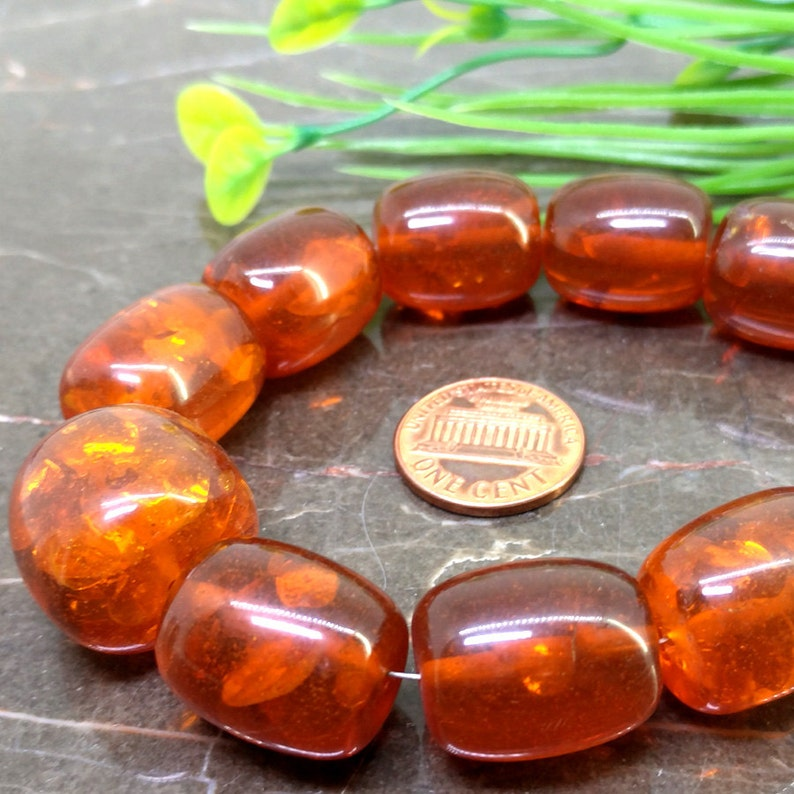 Natural Amber 12-20mm Smooth Barrel Gemstone Beads  Approx 20 pieces on 12 Inch long strand  JBC-ET-BAMB001